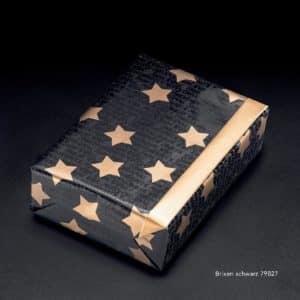 Emballage cadeau de Noël, couleur Noir avec motif étoiles dorées.