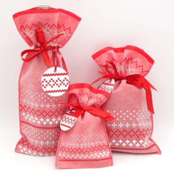 Pochons en tissu rouge et blanc au motif de flocons de neige. Idéal Noël.